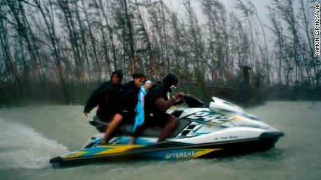 Jet skiers saved 100 people trapped in flooded homes in the Bahamas