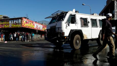 A police truck patrols an area affected by looters in Germiston, east of Johannesburg.