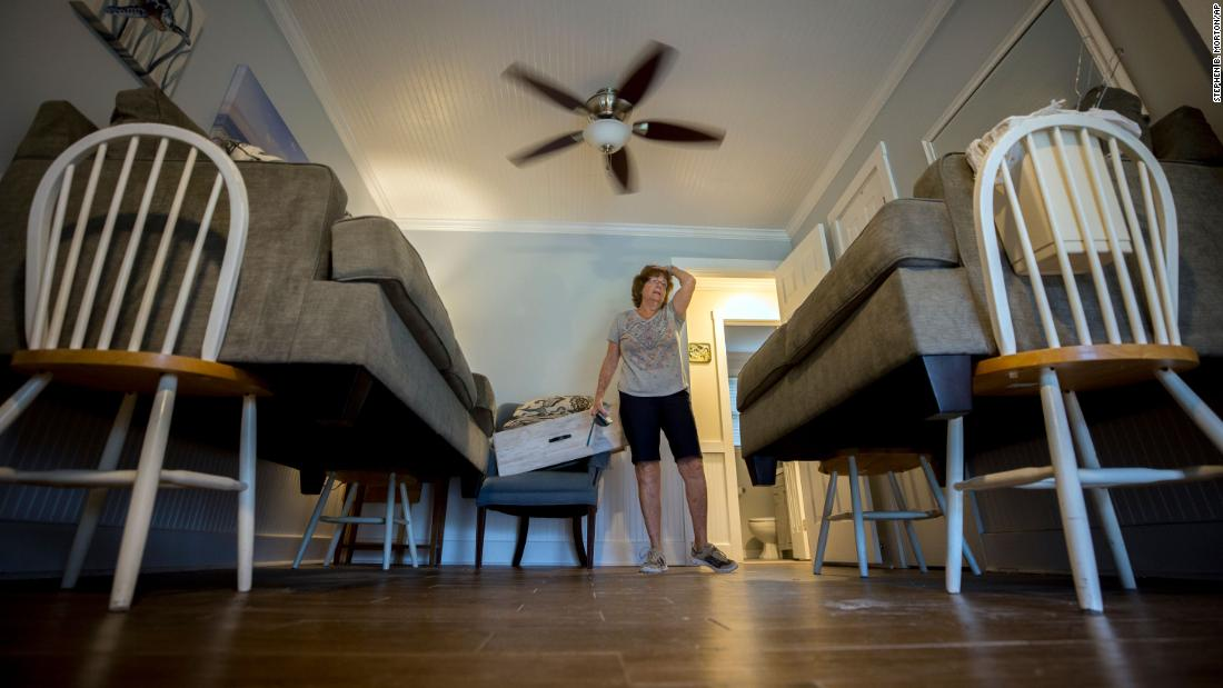 Debbie Pagan checks her raised furniture one last time before she and her husband evacuate their home in Tybee Island, Georgia, on September 4.