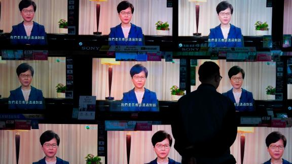 A man watches televisions at a store in Hong Kong as Chief Executive Carrie Lam announces the withdrawal of the extradition bill on Wednesday, September 4.