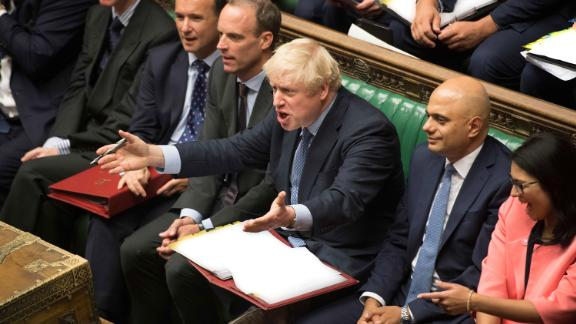 Boris Johnson reacts to Jeremy Corbyn during his first Prime Minister