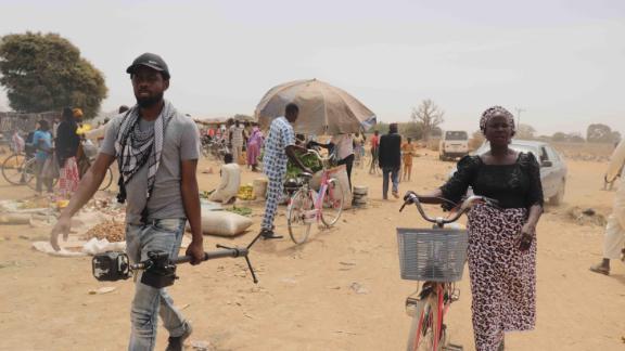 Yana Galang (R) and Joel Benson (L) at the market in Chibok