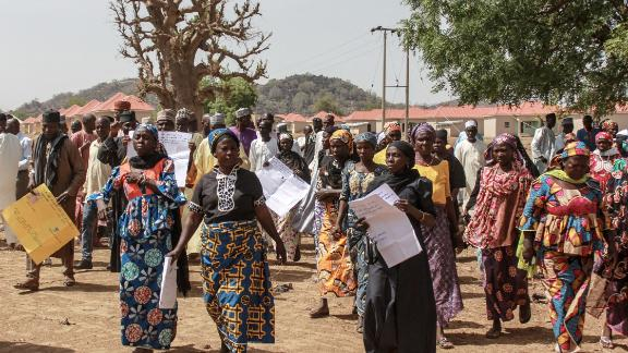 Parents and relatives arrives holding portraits of their girls for a commemoration five years after they were abducted by Boko Haram Jihadists group on April 14, 2019 at the Chibok Local Government.