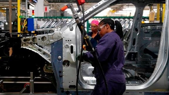 Workers assemble cars at the newly renovated Ford's Assembly Plant in Chicago, June 24, 2019. - The plant was revamped to build the Ford Explorer, Police Interceptor Utility and Lincoln Aviator. (Photo by JIM YOUNG / AFP)        (Photo credit should read JIM YOUNG/AFP/Getty Images)