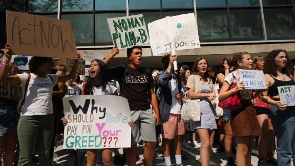 NEW YORK, NEW YORK - AUGUST 30: Youth led protesters demonstrate in front of the United Nations (UN) in support of measures to stop climate change during a weekly Friday gathering on August 30, 2019 in New York City. This week the young Swedish climate activist Greta Thunberg attended the event joined the dozens of other youths in the protest and march which demanded that politicians and others in power do more to halt a warming planet. Thunberg arrived into New York City on Wednesday aboard a sailboat after traveling across the Atlantic for 13 days to make a point about carbon footprints and global travel. The young activist will address a UN conference on climate change while in New York. (Photo by Spencer Platt/Getty Images)