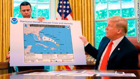 US President Donald Trump and Acting US Secretary of Homeland Security Kevin McAleenan update the media on Hurricane Dorian preparedness from the Oval Office at the White House in Washington, DC, September 4, 2019. (Photo by JIM WATSON / AFP)        (Photo credit should read JIM WATSON/AFP/Getty Images)