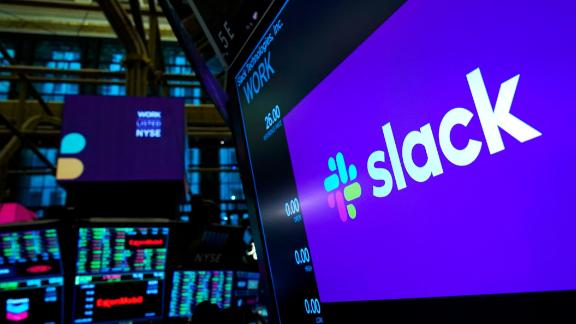 NEW YORK, NY - JUNE 20: The logo for Slack is displayed on a trading post monitor at the New York Stock Exchange (NYSE), June 20, 2019 in New York City. The workplace messaging app Slack will list on the New York Stock Exchange this morning. Shares of Slack were surging more than 60 percent over its reference price in early afternoon trading. (Photo by Drew Angerer/Getty Images)