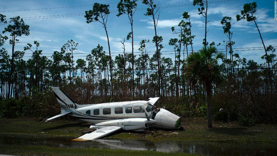 A broken plane lays on the side of a road in the Pine Bay neighborhood in the aftermath of Hurricane Dorian in Freeport, Grand Bahama, on September 4.