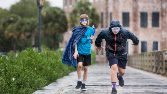 Braden Vick, right, and Scott Ray run along The Battery in Charleston, South Carolina, on September 4.