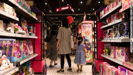 Customers walk past a toy display in South Korea, on September 3, 2017.