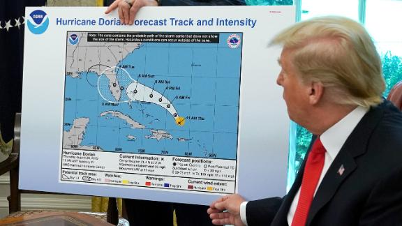 WASHINGTON, DC - SEPTEMBER 04: U.S. President Donald Trump (R) references a map held by acting Homeland Security Secretary Kevin McAleenan while talking to reporters following a briefing from officials about Hurricane Dorian in the Oval Office at the White House September 04, 2019 in Washington, DC. The map was a forecast from August 29 and appears to have been altered by a black marker to extend the hurricane