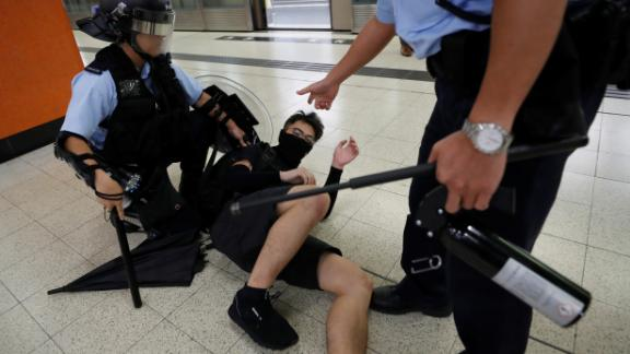 A protester is detained by police at the Po Lam Mass Transit Railway station on Thursday, September 5.