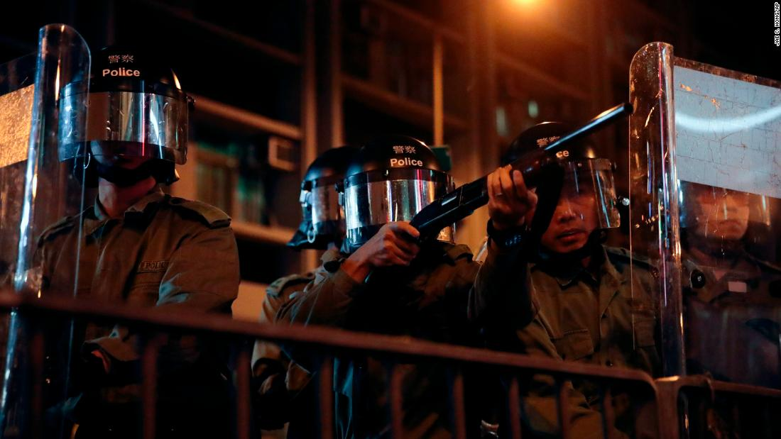 Police aim at protesters outside the Mong Kok police station on September 4.