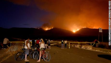 Residents watch as the Tenaja Fire burns in Murrieta, California.