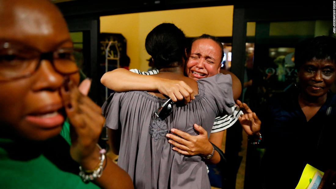 Roshane Eyma cries as she is greeted by members of her church after being rescued from Abaco Island and flown to Nassau, Bahamas, on September 4.