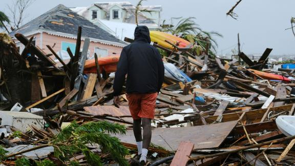 A man walks through the rubble left by Hurricane Dorian in Marsh Harbour, Bahamas, on September 2.