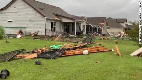 Pieces of roofs and siding were torn off homes Thursday morning in Carolina Shores, North Carolina, about 40 miles southwest of Wilmington.