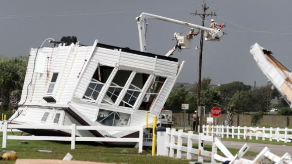 Workers try to restore power after a tornado hit Emerald Isle, North Carolina, on September 5. Several tornadoes were reported in the Carolinas.