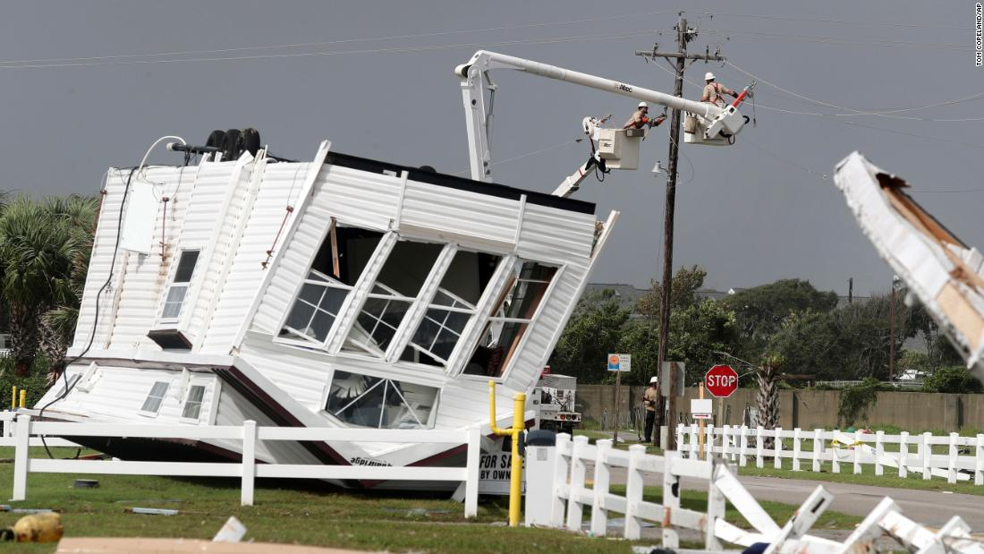 Power company linemen work to restore power after a tornado hit Emerald Isle, North Carolina, on September 5. Several tornadoes were reported in the Carolinas.