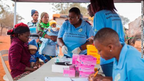 Health care workers test a mother and child for malaria at a border clinic in in Komatipoort, South Africa