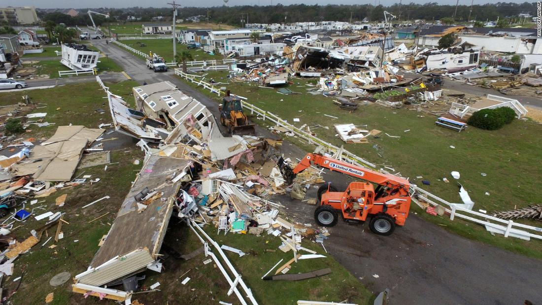 Emerald Isle, North Carolina, town employees work to clear the road after a tornado hit.