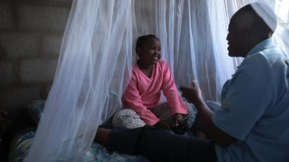 Sitting under a newly hung bednet in Mpumalanga province, South Africa
