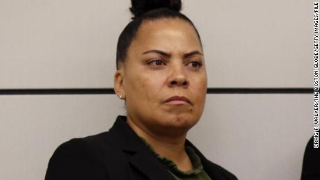 Suffolk County District Attorney Rachael Rollins listens to a speaker during a press conference on April 29, 2019.