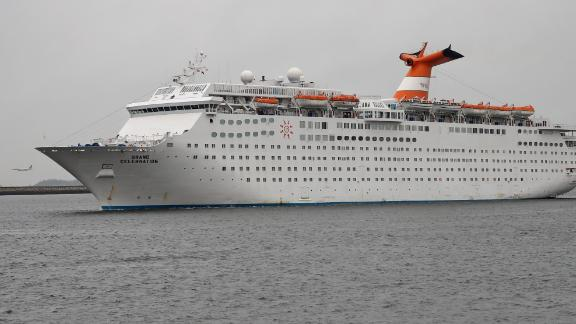 BOSTON, MA - OCTOBER 12: Grand Celebration, a cruise ship that will house gas workers in order to free up hotel space for those affected by gas crisis, sails into Boston Harbor on Oct. 12, 2018. (Photo by David L. Ryan/The Boston Globe via Getty Images)