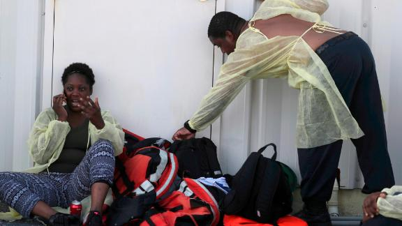 A woman from the Bahamas speaks on a cell phone after evacuating on September 5.