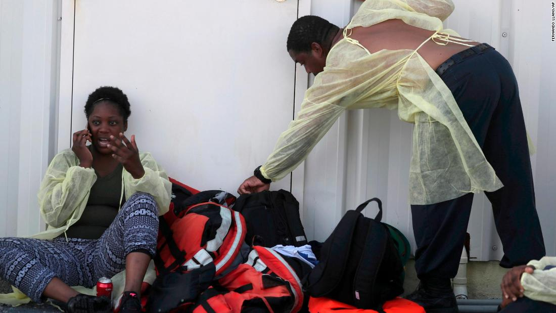 A woman speaks on a mobile phone after being evacuated along with others from the Abaco islands at a private airport in Nassau, Bahamas, on September 5.