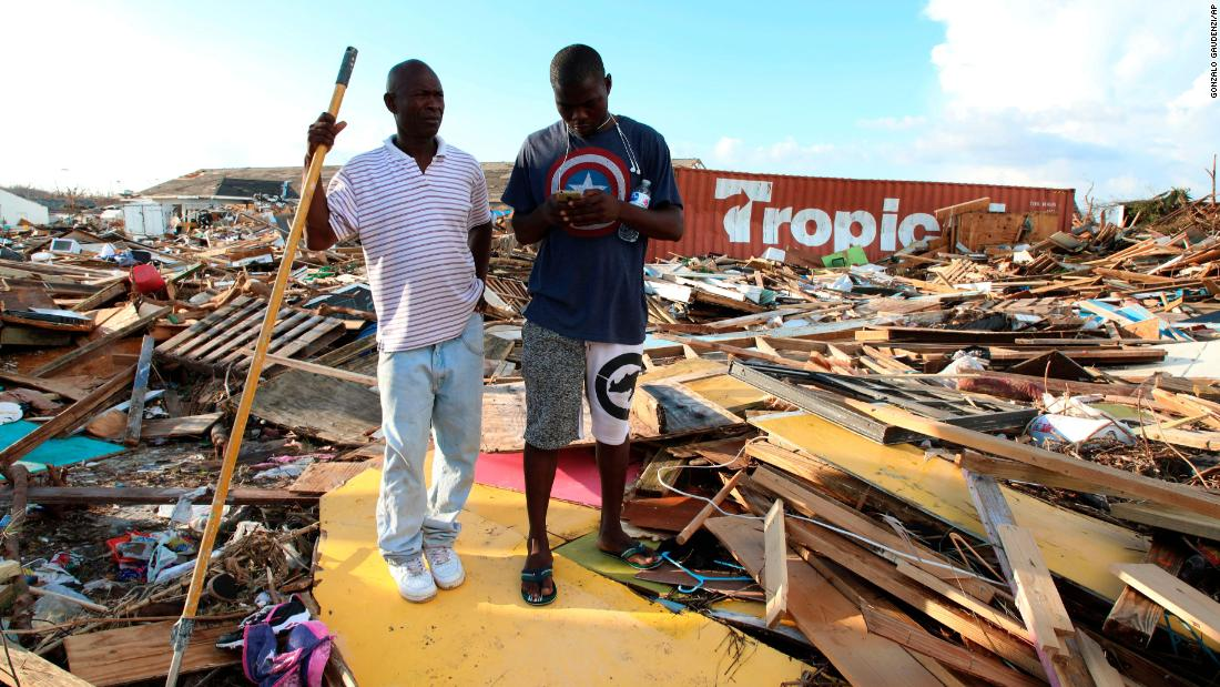 Two men stand amid the aftermath from Hurricane Dorian in The Mudd on Great Abaco Island, the Bahamas, on September 5.