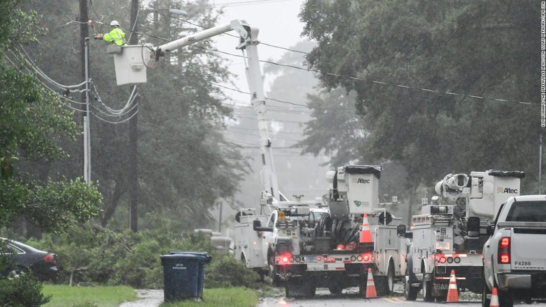 Utility crews work on restoring power in Myrtle Beach, South Carolina, on September 5.