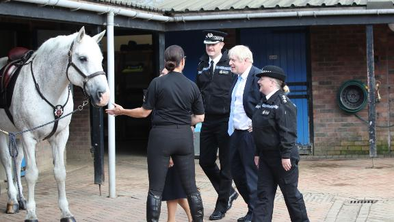 Prime Minister Boris Johnson was introduced to a police horse just before his speech.