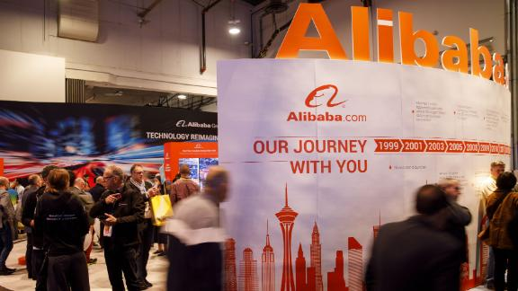 Attendees walk past the Alibaba Group Holding Ltd. booth at the 2019 Consumer Electronics Show (CES) in Las Vegas, Nevada, U.S., on Wednesday, Jan. 9, 2019. Dozens of companies will give presentations at the event, where attendance is expected to top 180,000, with the trade war between the U.S. and China as well as Apple's sales woes looming over the gathering. Photographer: Patrick T. Fallon/Bloomberg via Getty Images