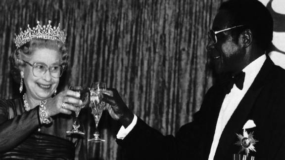 Britain's Queen Elizabeth II toasts Mugabe during a banquet in the Queen's honor in Harare in October 1991. The Queen had last visited the territory that became Zimbabwe in 1947.