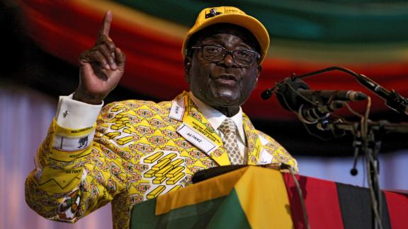 Mugabe delivers a speech at his party