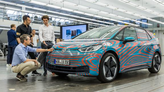 Employees inspect a Volkswagen ID.3 pre-production model electric automobile inside the Volkswagen AG design studio in Wolfsburg, Germany, on Friday, July 5, 2019. Traditional carmakers will be showing off electric models like VWsID.3and Porsche AG's Taycanin Frankfurt next week alongside profit mainstays of gas-guzzling sport utility vehicles.Photographer: Rolf Schulten/Bloomberg via Getty Images