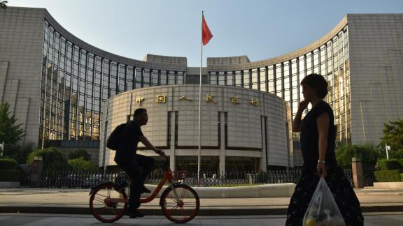BEIJING, CHINA - JUNE 18: A pedestrian walks past the People's Bank of China (PBOC) headquarters on June 18, 2019 in Beijing, China. China's import and export of trade in goods reached 12.1 trillion yuan in the first five months of this year, increasing 4.1 percent year-on-year, according to the General Administration of Customs. (Photo by Zhang Gang/Visual China Group via Getty Images)