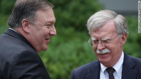 Mike Pompeo talks with  John Bolton before a in  Rose Garden news conference in June 2018.