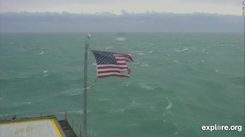 The flag on Frying Pan Tower is still flying despite suffering some abuse from Hurricane Dorian.
