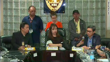 Press conference by the Philippines National Bureau of Investigation on Thursday. The 43-year-old American woman stands in the background.