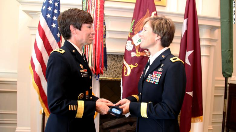 Maj. Gen. Maria Barrett presenting Brig. Gen. Paula Lodi a beret with one-star rank insignia as a tribute to the history of women serving in the Army and the historic moment of sisters serving together as General Officers.