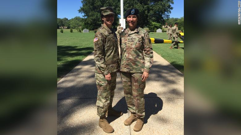 Maj. Gen. Maria Barrett and her sister, Brig. Gen. Paula Lodi, pose for a family photo after then Col. Lodi's outgoing Change of Command for the 44th Medical Brigade, Fort Bragg, N.C. in July 2018.