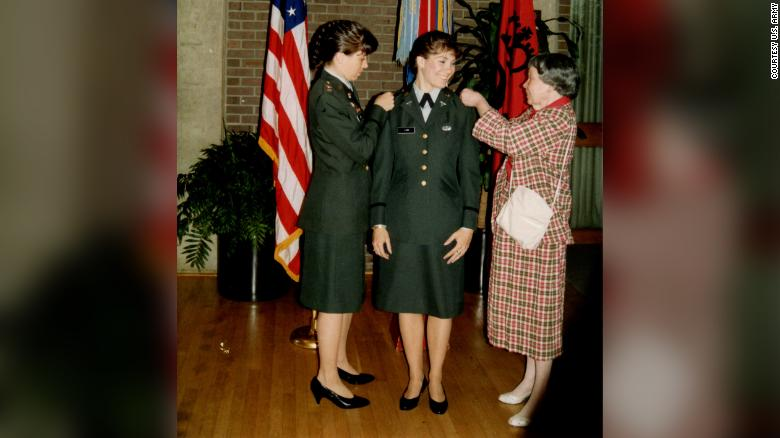 Maj. Gen. Maria Barrett and her mother, Clara Lodi, pin 2d Lt. rank on Paula Lodi during a commissioning ceremony at Rutgers University, 1990.