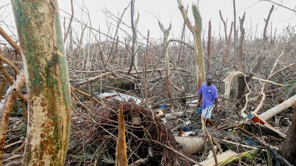GREAT ABACO, BAHAMAS - SEPTEMBER 6:  Wesley Joseph walks through fallen trees and debris on devastated Great Abaco Island on September 5, 2019 in the Bahamas. Hurricane Dorian hit the island chain as a category 5 storm battering them for two days before moving north.  (Photo by Jose Jimenez/Getty Images) (Photo by Jose Jimenez/Getty Images)