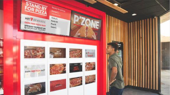 """Pizza Hut is working on """"cubbies"""" that make it easier for customers to pick up food they ordered."""
