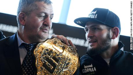 Mixed martial arts (MMA) fighter Khabib Nurmagomedov and and his father Abdulmanap Nurmagomedov give a press conference in Moscow on November 26, 2018.