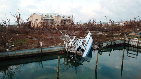 A boat sits turned on its side in the aftermath of Hurricane Dorian, in Marsh Harbor, Abaco Island.