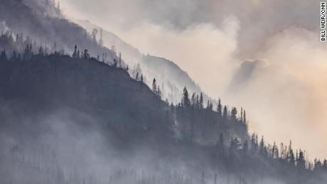 Smoke from the Swan Lake fire blankets a hillside