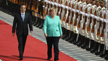 Chinese Premier Li Keqiang and Chancellor of Germany Angela Merkel review the Guard of Honour of the People's Liberation Army at The Great Hall Of The People on September 6 in Beijing.
